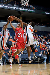 Davidson forward Mercedes Robinson (21) is fouled while shooting by Virginia guard Enonge Stovall (40).  The Virginia Cavaliers women's basketball team defeated the Davidson Wildcats 83-68 at the John Paul Jones Arena in Charlottesville, VA on December 20, 2007.