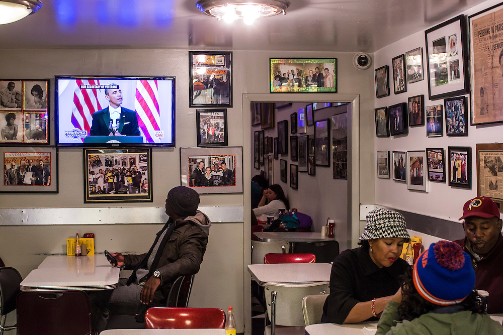 Dewayn Lewis of Washington, DC, watches President Barack Obama speak at the Inaugural Ball at Ben's Chili Bowl, a local institution which President Barack Obama has visited, on Monday, January 21, 2013 in Washington, DC.