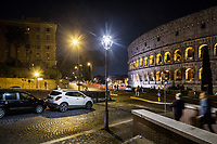 ROME, ITALY - 20 MARCH 2017: A white light LED lamppost (center, foreground) and yellow light sodium lampposts (background, left) are seen here by the Colosseum in Rome, Italy, on March 20th 2017.<br /> <br /> Rome is undergoing a city-wide plan to change its public illumination from the current yellow sodium street lights CK to white LED lamps. In making the change, Rome joins a long line of cities around the world that have switched to the cheaper, and more environmentally friendly LED lighting, and it is not the first city where that change has come at the price of protest.<br /> <br /> Since July, some 100,000 led lights have already been installed, just over half the number that will be substituted in the 53 million euro changeover that is expected to save the city millions of euros in electrical bills. But when Rome's municipal electrical utility ACEA began to substitute the lamps in Rome's historic center, residents began to take note.