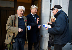"© Licensed to London News Pictures. 10/11/2018. London, UK. JO JOHNSON MP and his father STANLEY JOHNSON sign autographs as they leave BBC Broadcasting House in London after JO JOHNSON resigned as transport minister yesterday. Mr Johnson, brother of former foreign secretary Boris Johnson, resigned his ministerial post saying it's ""imperative we go back to the people and check"" they still want to leave. Photo credit: Ben Cawthra/LNP"