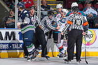 KELOWNA, CANADA - APRIL 3: Mike Langin and Nathan Van Oosten, linesman, gets between Tyrell Goulbourne #12 and Colton Heffley #25 of the Kelowna Rockets and Mitch Elliot #7 of the Seattle Thunderbirds on April 3, 2014 during Game 1 of the second round of WHL Playoffs at Prospera Place in Kelowna, British Columbia, Canada.   (Photo by Marissa Baecker/Getty Images)  *** Local Caption *** Tyrell Goulbourne; Mitch Elliott; Nathan Van Oosten; Colton Heffley; Mike Langin;