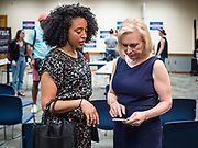"24 MAY 2019 - WEST DES MOINES, IOWA: US Senator KIRSTEN GILLIBRAND (D-NY), right, talks to ALEXANDRIA PHILLIPS, the campaign's traveling press secretary, after Gillibrand's forum on family rights in the West Des Moines Public Library. Gillibrand unveiled her ""Family Bill of Rights"" during a forum in West Des Moines. The New York Senator has made family health and rights a centerpiece of her campaign. She is touring Iowa this week to support her candidacy to be the Democratic nominee for the US Presidency. Iowa traditionally hosts the the first selection event of the presidential election cycle. The Iowa Caucuses will be on Feb. 3, 2020.           PHOTO BY JACK KURTZ"
