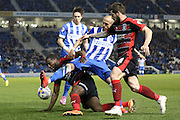 Ishmael Miller and Bruno Saltor draw it out at the AMEX during the Sky Bet Championship match between Brighton and Hove Albion and Huddersfield Town at the American Express Community Stadium, Brighton and Hove, England on 14 April 2015. Photo by Stuart Butcher.