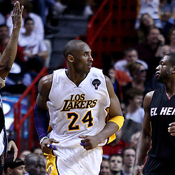 March 10, 2011; Miami, FL, USA; Los Angeles Lakers shooting guard Kobe Bryant (24) reacts after scoring over Miami Heat shooting guard Dwyane Wade (3) during the fourth quarter at the American Airlines Arena. The Heat defeated the Lakers 94-88.    Mandatory Credit: Derick E. Hingle