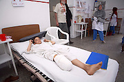 "July 2006: Victim of a landmine accident recovers in a Kabul hospital operated by the international medical group ""Emergency."" Afghanistan is one of the most heavily mined countries in the world.  Emergency builds hospitals to heal civilian victims of war."