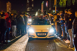 London, April 16th 2017. Hundreds of car enthusiasts gather with their souped up vehicles for the '2017 Tunnel Run', an where they take to the streets of London for a high speed 'cruise' through several of its tunnels and over bridges, cruising past famous landmarks. With complaints from some members of the public over noise and road safety grounds, police keep an eye on the drivers with the threat of siezing cars from unruly drivers. The event begins with a static meet-up at Canada Water before the cars set off on their cruise through the streets of the capital. PICTURED: Car enthusiasts encourage drivers to perform burnouts as they make their way through the car park.<br /> <br /> Credit: ©Paul Davey