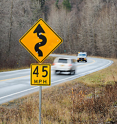 The Alaska Department of Transportation is proposing to widen and realign a 21.8-mile section of the two-lane Haines Highway (AK 7) near Haines, Alaska and bring the road up to federal highway standards. The department's goal is to widen the highway, replace the Chilkat River Bridge, help control landslides and bring the speed limit up from 50 to 55 mph by straightening curves, like this curve at mile 17 of the highway. Much of the rural highway travels through the Alaska Chilkat Bald Eagle preserve. <br /> <br /> Some Haines residents worry about the impact the straightening will have on a 15-mile section of the road through the preserve. Bald eagle perching and roosting trees, wetlands and salmon spawning habitat and cultural sites could potentially be affected. The straightening of the curve shown is one of the curves which would require significant work including wetland mitigation and stream relocation.<br /> <br /> The Alaska Chilkat Bald Eagle Preserve is the location of one of the largest gatherings of bald eagles in the world each fall. The 48,000 acre area was designated as a preserve in 1982. The Haines Highway is the only road access to Haines. The 152 mile highway travels from Haines, Alaska to Haines Junction, Yukon in Canada where it connects with the Alaska Highway and continental highway system.