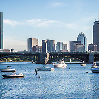 Boston Skyline panorama photo with the Longfellow Bridge. Includes John Hancock Tower, Prudential Tower and boats along the Charles River. Boston Massachusetts is a major city in the Eastern United States of America. Panoramic photo ratio is 1:3.