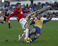 Photo: Paul Thomas.<br /> Mansfield Town v Walsall. Coca Cola League 2. 20/01/2007.<br /> <br /> Craig Pead (L) of Walsall is tackled by Jonathan D'Laryea.