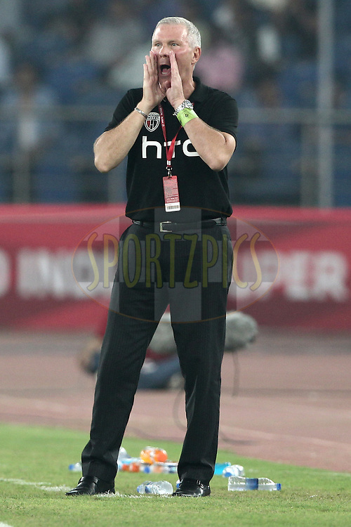 NorthEast United FC coach Ricki Herbert react during match 16 of the Hero Indian Super League between The Delhi Dynamos FC and NorthEast United FC held at the Jawaharlal Nehru Stadium, Delhi, India on the 29th October 2014.<br /> <br /> Photo by:  Deepak Malik/ ISL/ SPORTZPICS