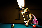 Melissa plays pool in Athens, Ohio on May 30, 2006.
