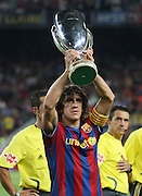 FC Barcelona's captain Carlos Puyol with the Supercup of Europe before La Liga match.August 31 2009.