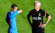 Dutch international football player Ibrahim Afellay and coach Bert van Marwijk during the training for the trainingcamp of the Netherlands national football team in Hoenderloo on May 28, 2012. AFP PHOTO/ ROBIN UTRECHT