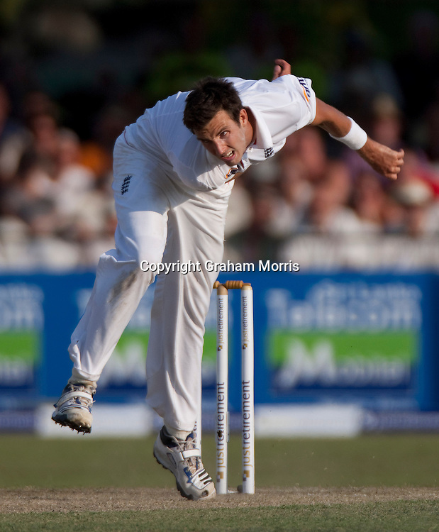 A contorted Steven Finn bowls during the second and final Test Match between Sri Lanka and England at the P. Saravanamuttu Stadium in Colombo. Photo: Graham Morris (Tel: +44(0)20 8969 4192 Email: sales@cricketpix.com) 03/04/12