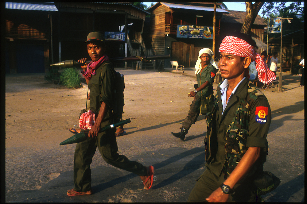 Government soldiers mobilize to counter attack the Khmer Rouge after the Maoist rebel group over ran the town of Siem Reap during the lead up to UN sponsored elections...Siem Reap, Cambodia.  May 1993...Photo © J.B. Russell..