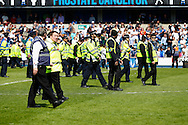 Police and security staff clear the pitch of fans after the Sky Bet Championship match at The Den, London<br /> Picture by David Horn/Focus Images Ltd +44 7545 970036<br /> 03/05/2014