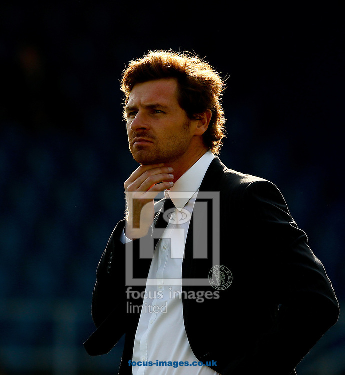 Picture by Andrew Tobin/Focus Images Ltd. 07710 761829. 23/10/11. A backlit Andre Villas Boas, manager of Chelsea looks on before the Barclays Premier League match between QPR and Chelsea at Loftus Road, London.