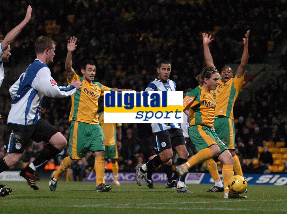 Photo: Ashley Pickering.<br />Norwich City v Sheffield Wednesday. Coca Cola Championship. 09/12/2006.<br />Norwich players appeal for handball