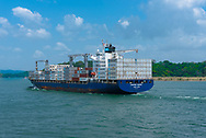 Panama Canal, Panama--April 18, 2018. A fully loaded container ship sails down the Panama Canal. Editorial use only.