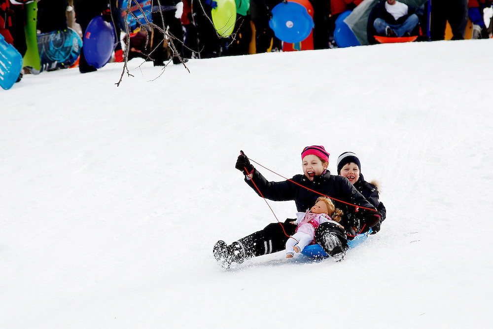 Kids snow sledding  in Central Park  on January 27, 2011 in New York City..Photo by Joe Kohen for The New York Times