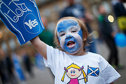 © Licensed to London News Pictures. 16/09/2014. Glasgow, UK. Keira Gunn Murphy, 4 year-old, attending to a mass meeting by Yes voters and campaigners at George's Square in Glasgow city centre on the evening of Tuesday, 16 September, two days ahead of the Scottish independence referendum. Photo credit : Tolga Akmen/LNP