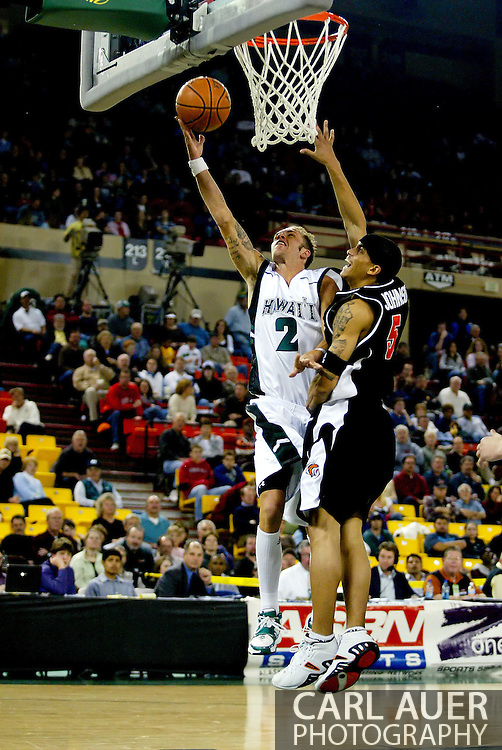 11/25/2006 - Anchorage, Alaska: Junior guard Matt Gibson (2) of the Hawaii Warriors goes for two over Sophomore guard Steffan Johnson (5) of the Pacific Tigers as Hawaii beat Pacific 71-60 to give the Warriors a third place finish in the 2006 Great Alaska Shootout<br />