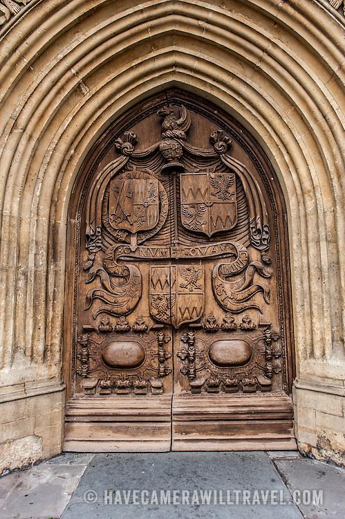A heavy wooden oak door on the West Front of Bath Abbey, Bath, Somerset.