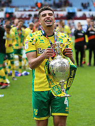 Norwich City's Ben Godfrey celebrates with the trophy after winning the Sky Bet Championship at Villa Park, Birmingham.