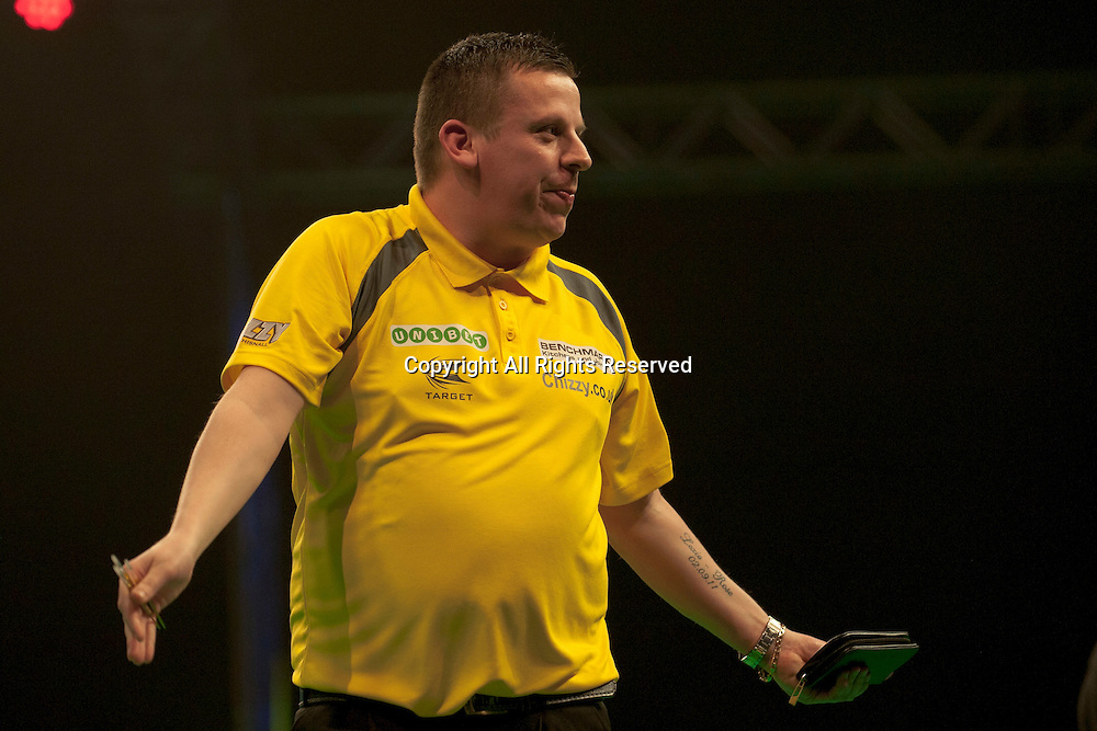 31.01.2016. ArenaMK, Milton Keynes, England. Unibet Masters Darts Championship.  Dave Chisnall [ENG] in action during his semi final match against James Wade [ENG]. Dave Chisnall [ENG] won the match 11-6.