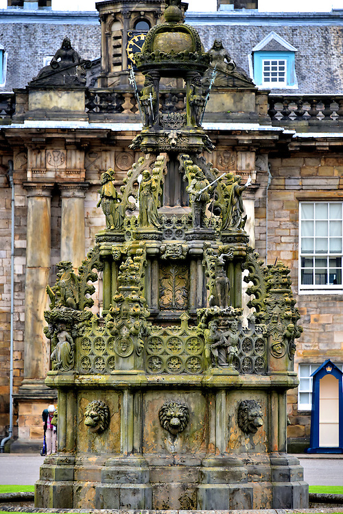 Courtyard Fountain at Holyrood Palace in Edinburgh, Scotland<br /> Prior to the construction of the Palace of Holyroodhouse, the main residence for Scottish monarchs during the 15th and 16th centuries was Linlithgow Palace. King James V, who was born there, added an ornate fountain to the courtyard. This fountain at Holyrood Palace is a 19th century replica. It was commissioned by Queen Victoria. Among the carvings of lions and soldiers are historic figures in Scotland&rsquo;s history.