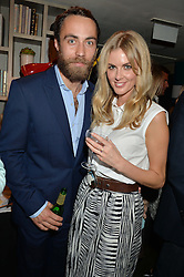 JAMES MIDDLETON and DONNA AIR at the Cavan.com Pop-Up sale held at The Belgraves Hotel, 20 Chesham Place, London on 20th May 2014.