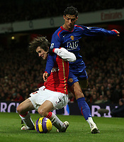 Photo: Paul Thomas.<br /> Arsenal v Manchester United. The Barclays Premiership. 21/01/2007.<br /> <br /> Cristiano Ronaldo is tackled by Tomas Rosicky (L).