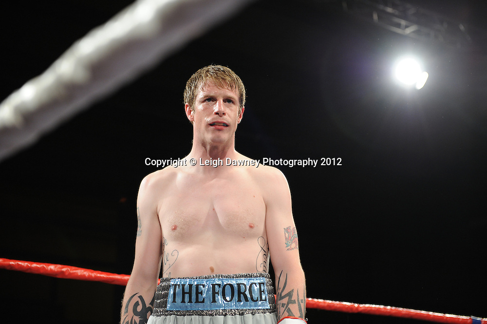 Rick Godding (silver yellow shorts) defeats James Flinn in a 6x3 min Welterweight contest at the Bowlers Exhibition Centre, Manchester, on the 2nd June 2012. Frank Maloney Promotions © Leigh Dawney Photography 2012.
