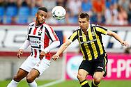 09-08-2015 VOETBAL: WILLEM II-VITESSE:TILBURG<br /> Denys Oliinyk van Vitesse in duel met Funso Ojo van Willem II <br /> <br /> Foto: Geert van Erven