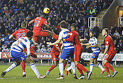 Blackburn Rovers midfielder, Hope Akpan jumps highest to clear the ball from a corner during the Sky Bet Championship match between Reading and Blackburn Rovers at the Madejski Stadium, Reading, England on 20 December 2015. Photo by Andy Walter.