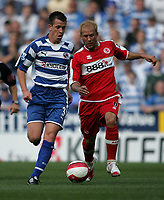 Photo: Lee Earle.<br /> Reading v Middlesbrough. The Barclays Premiership. 19/08/2006. Reading's Nicky Shorey (L) battles with Gaizka Mendieta.