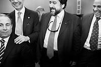 Palermo, Italy, 25 October 2012: L-R) Candidate for the Sicilian Regional Assembly Salvatore Luna, 53, congressman and founder of Fareitalia Adolfo Urso, 55,  Marshal of Carabinieri and Director of CESD Onlus Calogero Di Carlo, 53, and coordinator of CESD Onlus Enrico Bonavita laugh before a group photo during candidate for Governor of Sicily Nello Musumeci's campaign at the Astoria Palace Hotel in Palermo, on October 25 2012. Marshal Calogero di Carlo was under investigation for bribery in the trial to the so-called moles in the Palermo Antimafia directorate. <br /> <br /> The direct elections in Sicily for the President of the Region and its representatives will take place on Sunday 28 October 2012, 6 months ahead of the end of the terms of office of the current legislature. The anticipated election of October 28 take place after Raffaele Lombardo, former governor of Sicily since 2008, resigned on July 31st. Raffaele Lombardo is under investigation since 2010 for Mafia ties. His son Toti Lombardo is currently running for a seat in the Sicilian Regional Assembly in the coalition of Gianfranco Micciché, a candidate for the Presidency of the Region. 32 candidates belonging to 8 of the 20 parties running for the Sicilian elections are either under investigation or condemned. ### Palermo, Italia, 25 ottobre 2012: Il candidato all'Assemblea Regionale Siciliana (ARS) Salvatore Luna, 53 anni, il deputato e fondatore di Fareitalia Adolfo Urso, 55, il maresciallo dei Carabinieri e direttore del CESD Onlus Calogero di Carlo, 53, e il coordinatore del CESD Onlun Enrico Bonavita ridono prima di una foto di gruppo durante la campagna elettorale del candidato alla Presidenza della Regiona Sicilia Nello Musumeci all'Astoria Palace Hotel a Palermo, Italia, il 25 ottobre 2012. Il maresciallo dei carabinieri Calogero Di Carlo è stato indagato per concussione nel processo Talpe alla Dda di Palermo. <br /> <br /> Le elezioni in Sicilia per la votazione diretta del presidente della reg