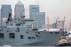 © Licensed to London News Pictures. 11/05/2015.  HMS Ocean has left London after a five day visit in which she helped commemorate the 70th anniversary of VE Day. The Royal Navy's largest warship was moored at Greenwich for the duration of her visit and departed this morning just after 6am. Credit : Rob Powell/LNP
