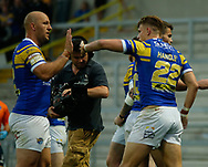Ash Handley (R) of Leeds Rhinos celebrates scoring his try against Wakefield Trinity with team mates Carl Ablett  (L) during the Betfred Super League match at Emerald Headingley Stadium, Leeds<br /> Picture by Stephen Gaunt/Focus Images Ltd +447904 833202<br /> 13/07/2018