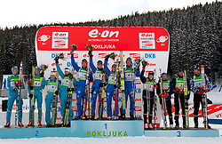 Second placed relay of Ukraine, winning team of Sweden and third placed team of France during flower ceremony after the Mixed 2x6 + 2x7,5km relay of the e.on IBU Biathlon World Cup on Saturday, December 19, 2010 in Pokljuka, Slovenia. The fourth e.on IBU World Cup stage is taking place in Rudno polje - Pokljuka, Slovenia until Sunday December 19, 2010. (Photo By Vid Ponikvar / Sportida.com)