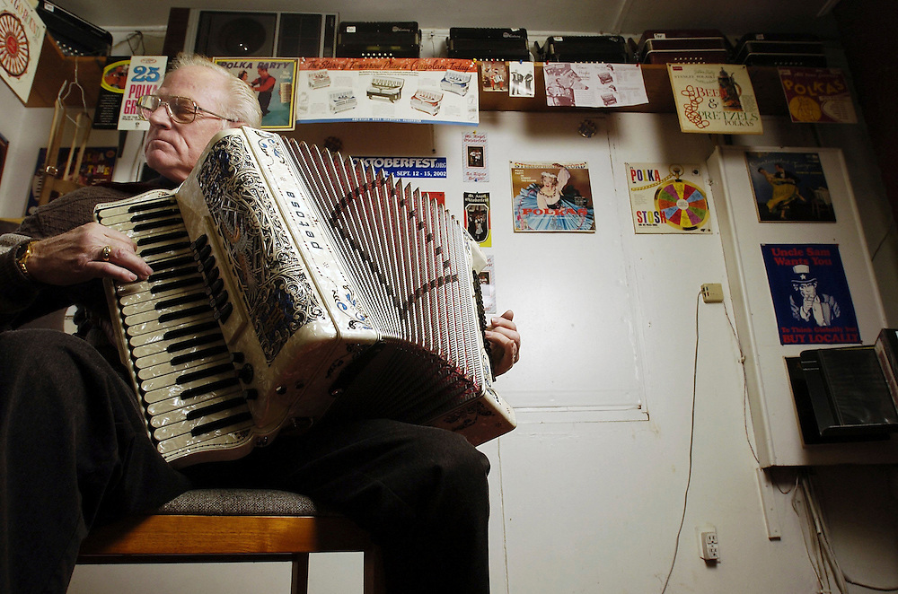 "Dick Moles plays his accordion at his appliance store on State Street NE. He will be playing at Historic Deepwood Estate ""Evening Paris."""