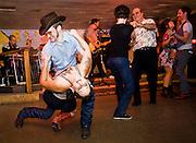 Joel Gammage (left) dips Whitney Barnett (right) during a dance at the Broken Spoke dance hall on Thurs., Sept. 28, 2012.<br /> Ashley Landis FOR AMERICAN STATESMAN
