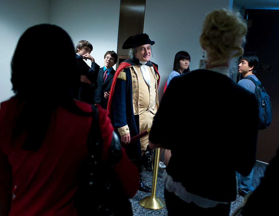 Jul 20, 2010 - Washington, District of Columbia, U.S., - Dressed as George Washington, JAMES RENWICK MANSHIP, SR, talks with others waiting to enter the Senate Judiciary Committee meeting on Tuesday. The committee voted, 13-6, in favor of Solicitor General Kagan's confirmation to the Supreme Court. The vote was largely along party lines except for Senator Lindsey Graham, (R-S.C.),  who broke ranks with his GOP colleagues by supporting her. The full Senate is expected to take up Kagan's nomination in early August..(Credit Image: © Pete Marovich/ZUMA Press)