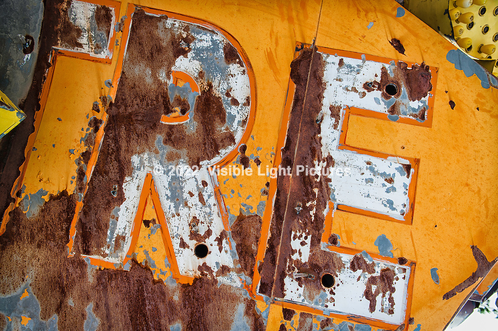 Two letters from a rusted sign