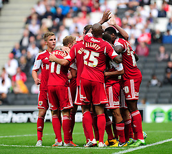 GOAL CELEBRATIONS. The Bristol City team celebrate after Bristol City's captain, Sam Baldock scores  - Photo mandatory by-line: Dougie Allward/JMP - Tel: Mobile: 07966 386802 24/08/2013 - SPORT - FOOTBALL - Stadium MK - Milton Keynes -  Milton Keynes Dons V Bristol City - Sky Bet League One