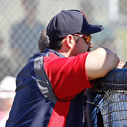 February 19, 2011; Fort Myers, FL, USA; Boston Red Sox first baseman Adrian Gonzalez (28) watches batting practice from behind the cage during spring training at the Player Development Complex.  Mandatory Credit: Derick E. Hingle