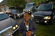 2006.06.24 RUDIJOHNSON SPORTS : The Cincinnati Bengals Rudi Johnson poses with his luxury automobiles in the driveway of his Amberly home Saturday June 24, 2006. He has a Bentley, two Mercedes and a Range Rover Sport. The Enquirer/Jeff Swinger