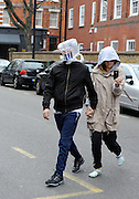 01.DECEMBER.2011. LONDON<br /> <br /> KATE HUDSON AND MATT BELLAMY WALKING HOME FROM THE GYM, MATT IS WEARING A TESCO BAG OVER HIS HEAD WITH EYE HOLES<br /> <br /> BYLINE: EDBIMAGEARCHIVE.COM<br /> <br /> *THIS IMAGE IS STRICTLY FOR UK NEWSPAPERS AND MAGAZINES ONLY*<br /> *FOR WORLD WIDE SALES AND WEB USE PLEASE CONTACT EDBIMAGEARCHIVE - 0208 954 5968*