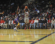 "Ole Miss guard Chris Warren (12)  shoots at the C.M. ""Tad"" Smith Coliseum in Oxford, Miss. on Wednesday, February 9, 2011. Ole Miss won 66-60 and is now 4-5 in the Southeastern Conference."