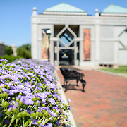 Sackler Gallery Entrance with Flowers. Entrance of the Sackler Gallery from the Enid A. Haupf Garden. The Arthur M. Sackler Gallery, located behind the Smithsonian Castle, showcases ancient and contemporary Asian art. The gallery was founded in 1982 after a major gift of artifacts and funding by Arthur M. Sackler. It is run by the Smithsonian Institution.